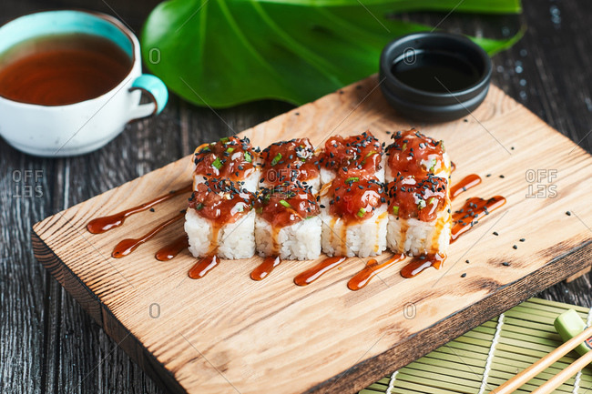 Japanese dish for lunch sushi rolls with sauce and Asian tea