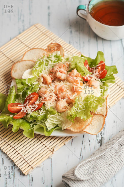 large Caesar salad with crackers and shrimp home delivery meal lunch