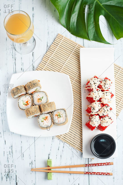 set for lunch sushi rolls served on a wooden table at home lunch