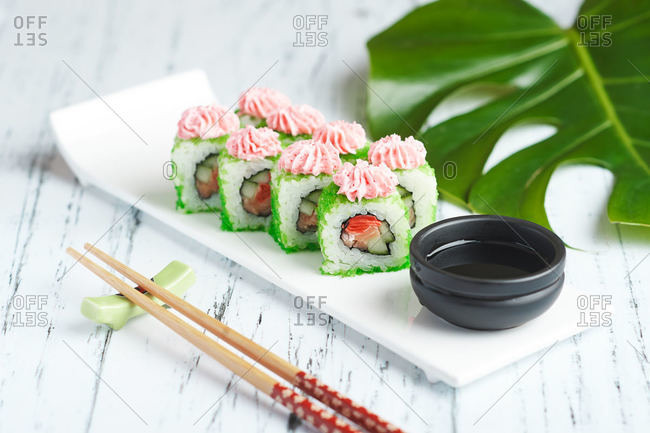 sushi rolls california with salmon for lunch with food delivery