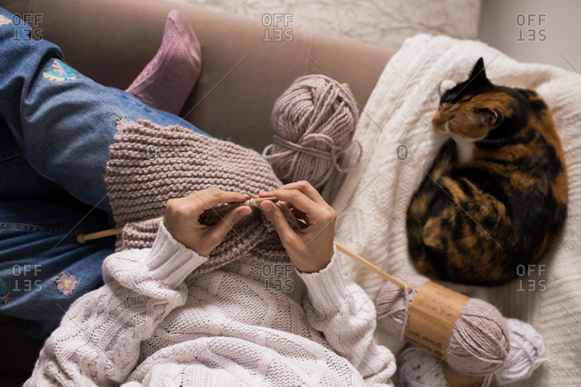 Overhead view of woman knitting at home