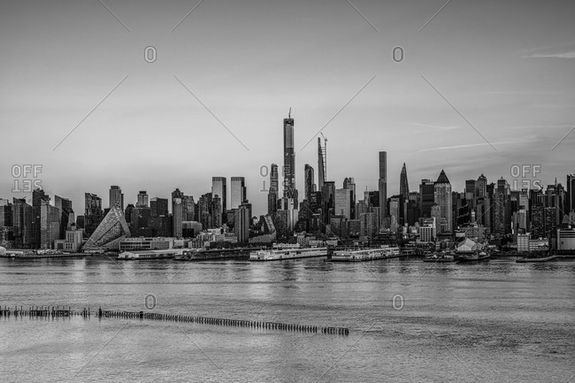 New York City, New York, USA - January 15, 2020: Sunset over the Hudson River, West Midtown and Manhattan Buildings in black and white