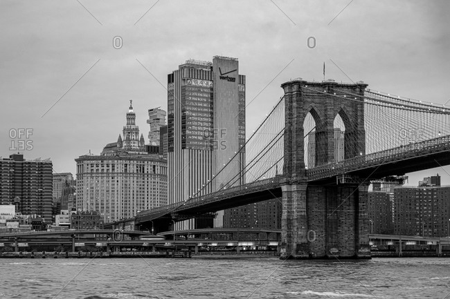 New York City, New York, USA - January 9, 2020: View of the Brooklyn bridge and buildings in Manhattan in black and white
