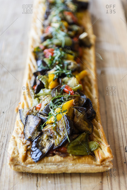 Long veggie pie made with Provencal vegetables on puff pastry