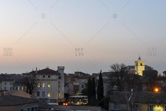 L'Isle-sur-la-Sorgue, Vaucluse, France - February 9, 2018: View over the city of L'Isle-sur-la-Sorgue at dusk
