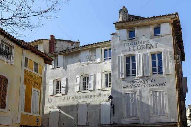 L'Isle-sur-la-Sorgue, Vaucluse, France - February 9, 2018: Old buildings in the city of L'Isle-sur-la-Sorgue