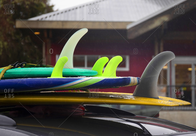 Rack of surfboards tied to top of car in Tofino, Vancouver Island, British Columbia, Canada