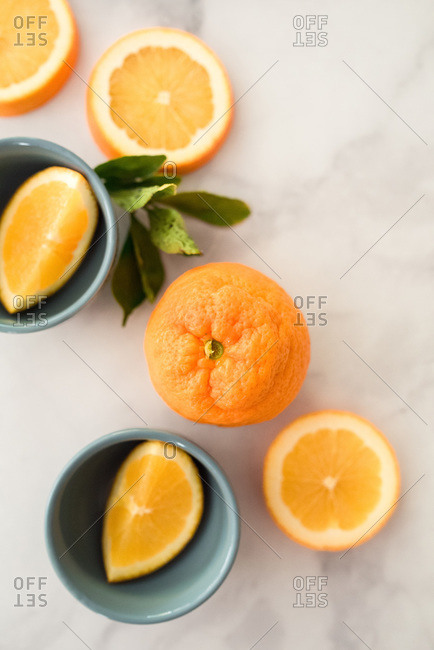 Flatlay of citrus oranges on white