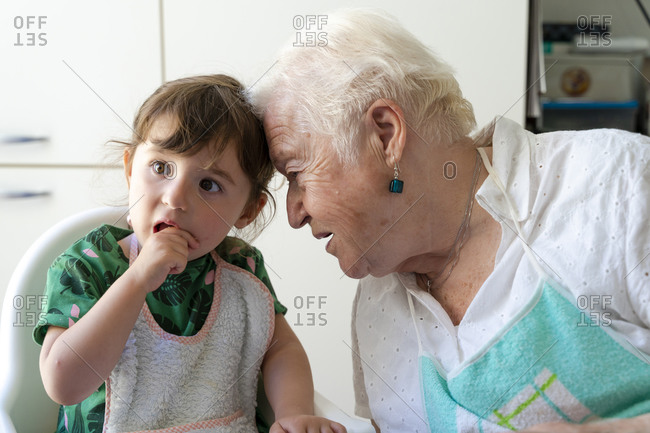 grandmother and granddaughter resting their heads with love