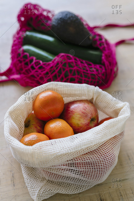 Eco friendly and reusable shopping mesh bag with fruits and vegetables