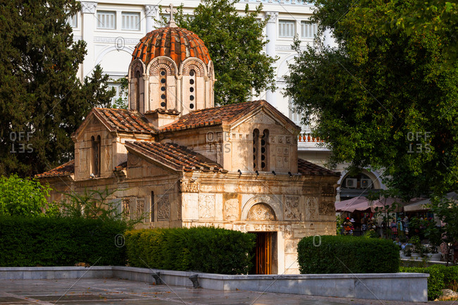 Historic Byzantine-era church with stone carvings on the exterior wall