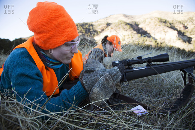 Paonia, Colorado, United States - November 14, 2015: Two female hunters ready their rifles to shoot elk in Colorado