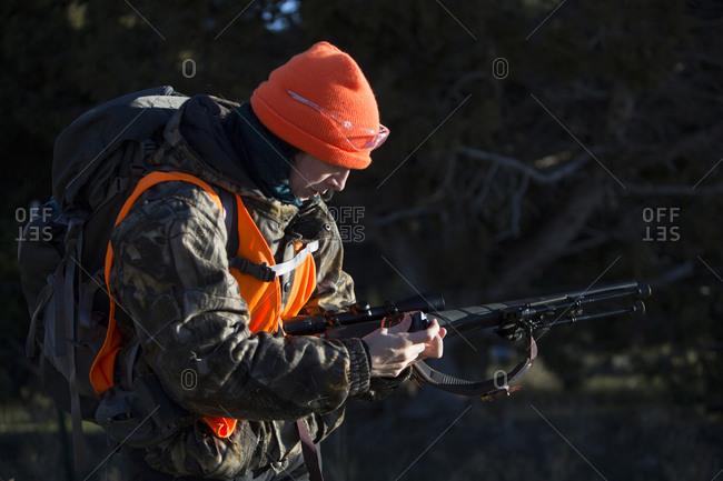 Paonia, Colorado, United States - November 15, 2015: Female hunter loads her gun in Paonia, Colorado
