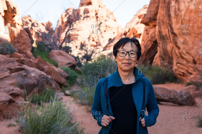 Portrait of Senior Asian Woman hiking in the desert landscape