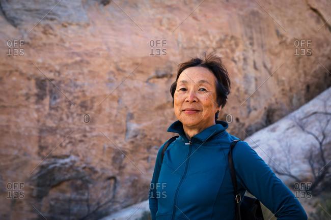 Portrait of Senior Asian Woman in the desert landscape