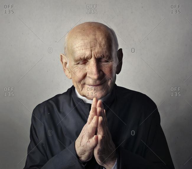 portrait of priest in prayer