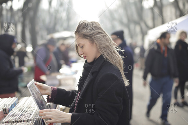 beautiful woman choose a vinyl in a vintage market