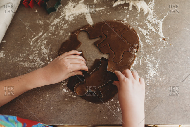 Close up of Child's Hands Making Gingerbread Men Cookies
