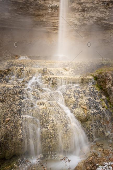 Waterfall cascading down stone - long exposure