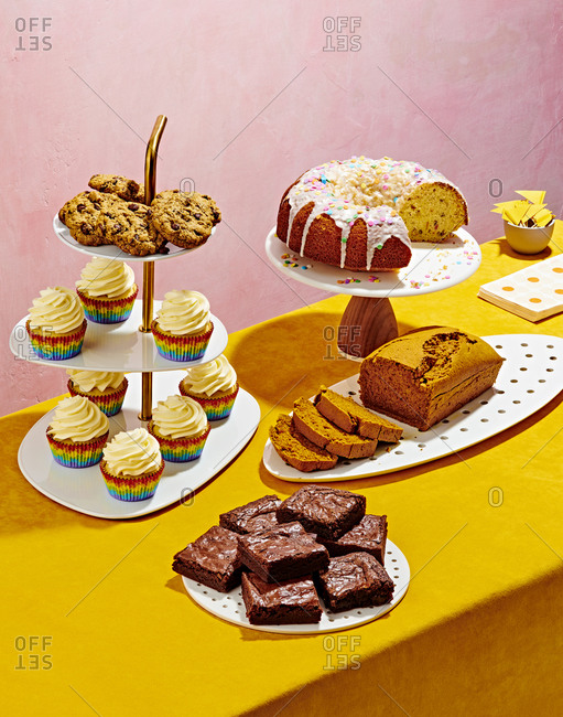Colorful Baked Goods Spread on Pink and Yellow