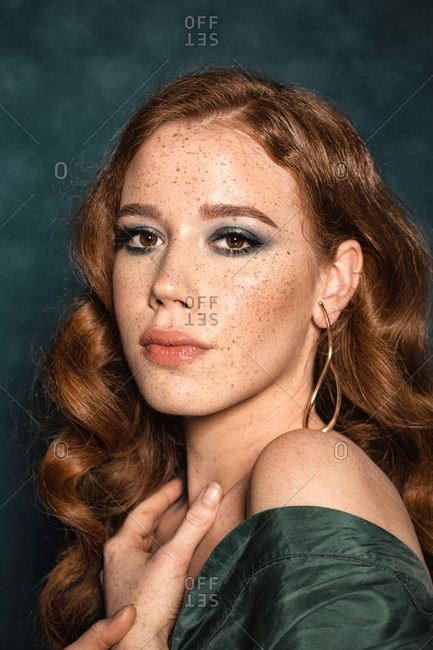 Beautiful ginger girl with freckles posing