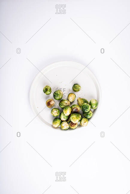 Brussel sprouts on white plate
