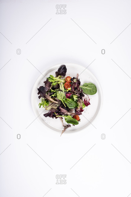 Overhead view of salad on white background