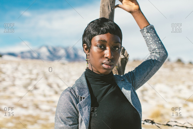Young African American woman standing in rural Colorado