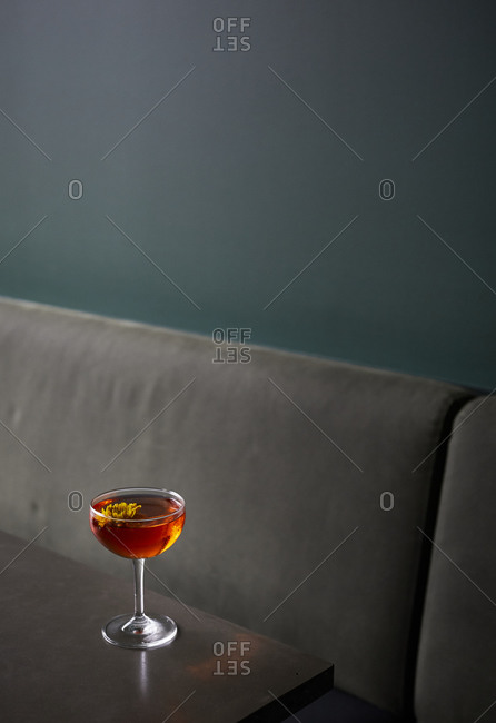 Single cocktail on table in restaurant