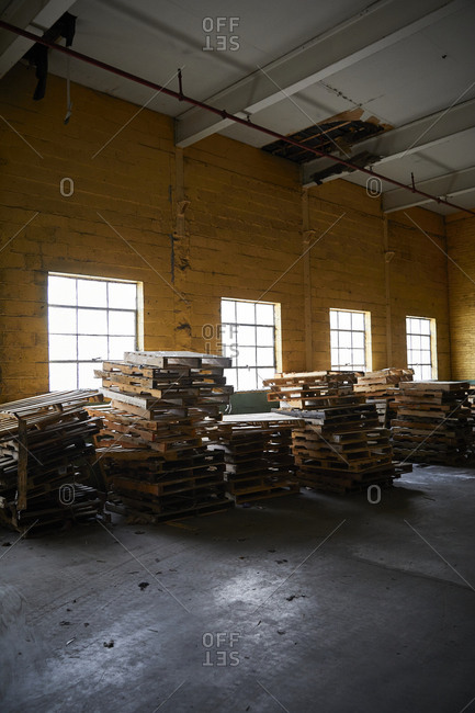 Stacks of palettes in warehouse
