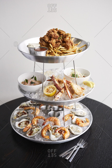 Seafood tower with shrimp, crab legs and fries