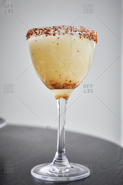 Spicy rim cocktail with neutral background