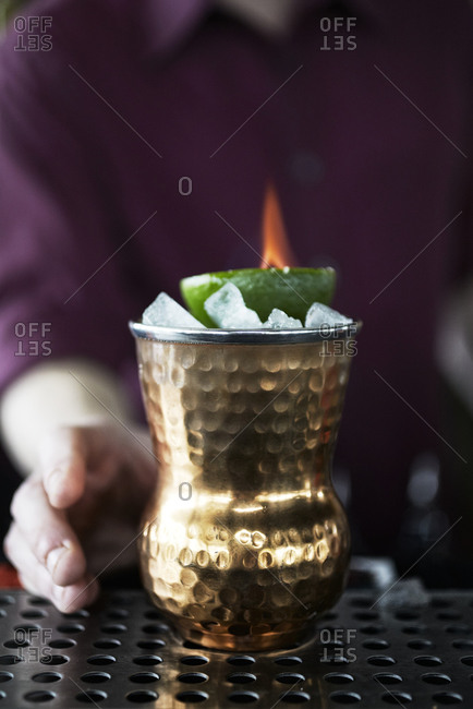 Flaming cocktail in a copper cup