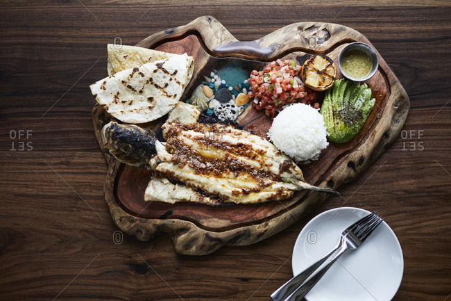 Seafood taco plate with whole fish