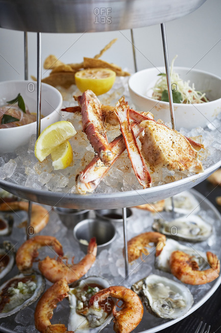 Crab legs on a seafood tower with shrimp
