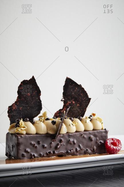 Delicious hocolate dessert with raspberries