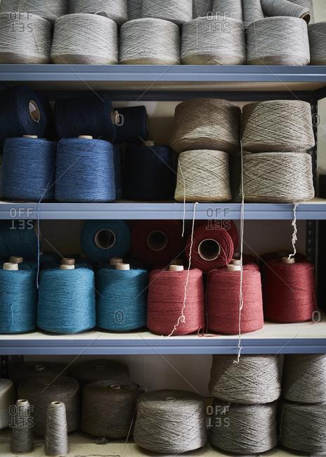 Spools of colorful thread on a shelf