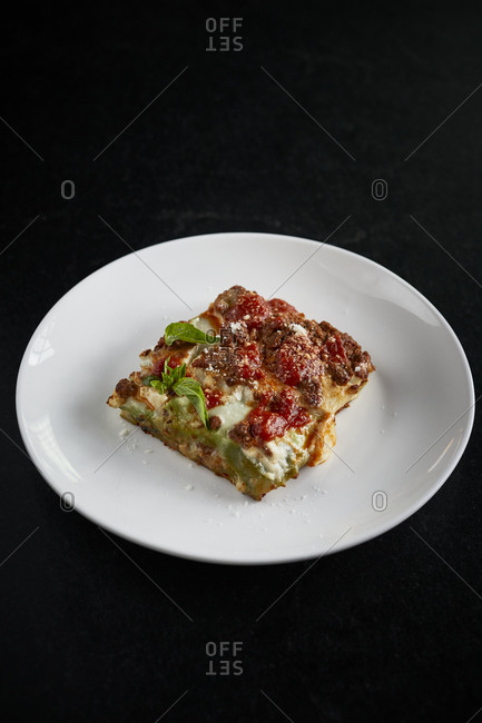 Meat lasagna on white plate