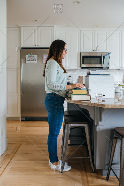 Woman working from home in the kitchen