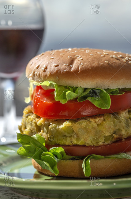 Homemade healthy vegan green lentil burger with tomato, lettuce and French fries