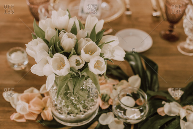 Elegant banquet with flowers under tent