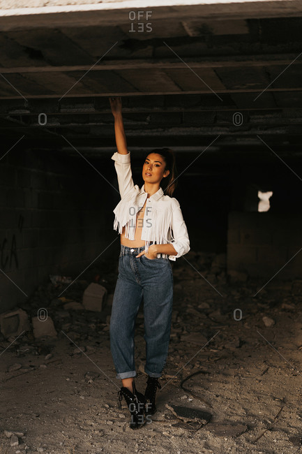 Sensitive young female model inside abandoned building