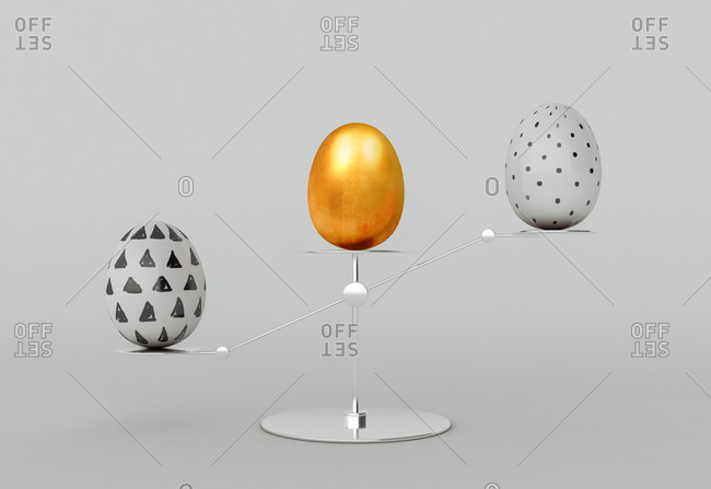 Balance concept with painted decorated Easter eggs on grey background