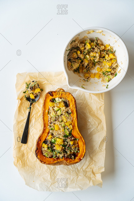 Vegan stuffed pumpkin with quinoa and vegetables