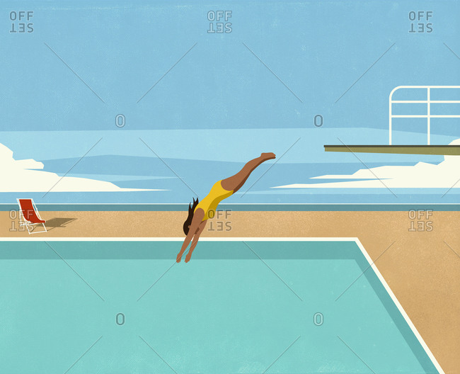 Girl diving into swimming pool