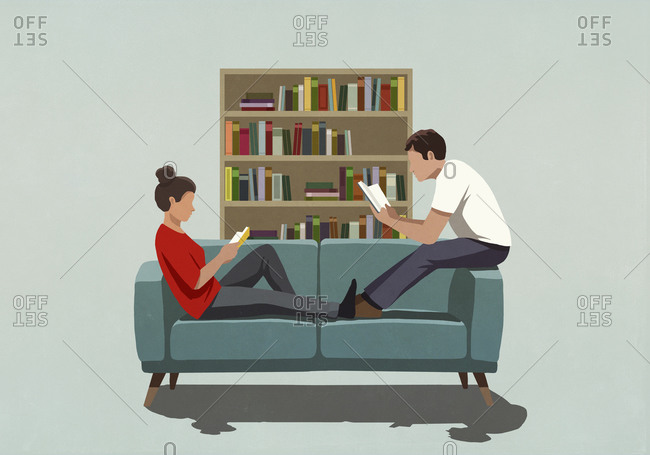 Couple reading books on sofa at home