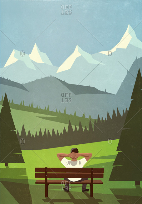 Man on bench enjoying scenic mountain landscape view