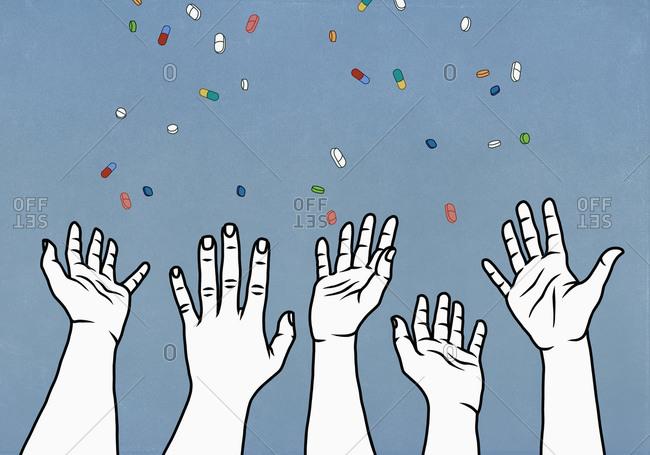 Hands reaching for falling prescription medicine