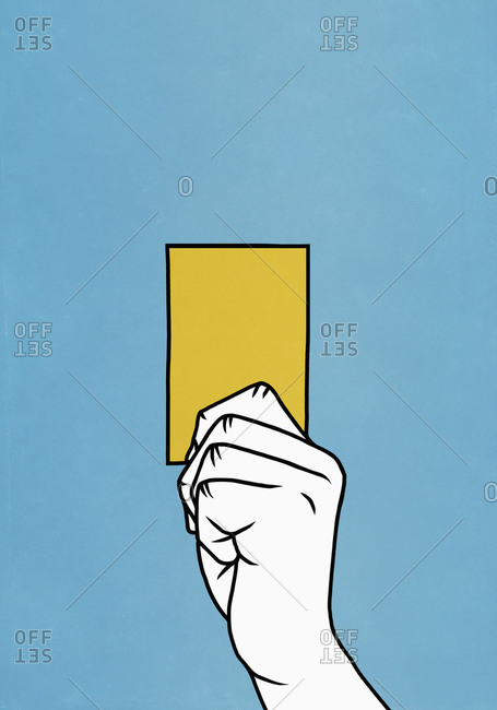 Hand holding yellow card on blue background