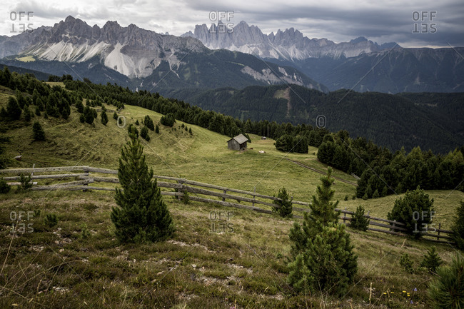 A view of The Dolomites and a wooden cabin near to the ski resort of Plose, South Tyrol, Italy.
